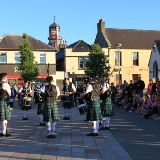 Scottish Bagpipers in Kilts